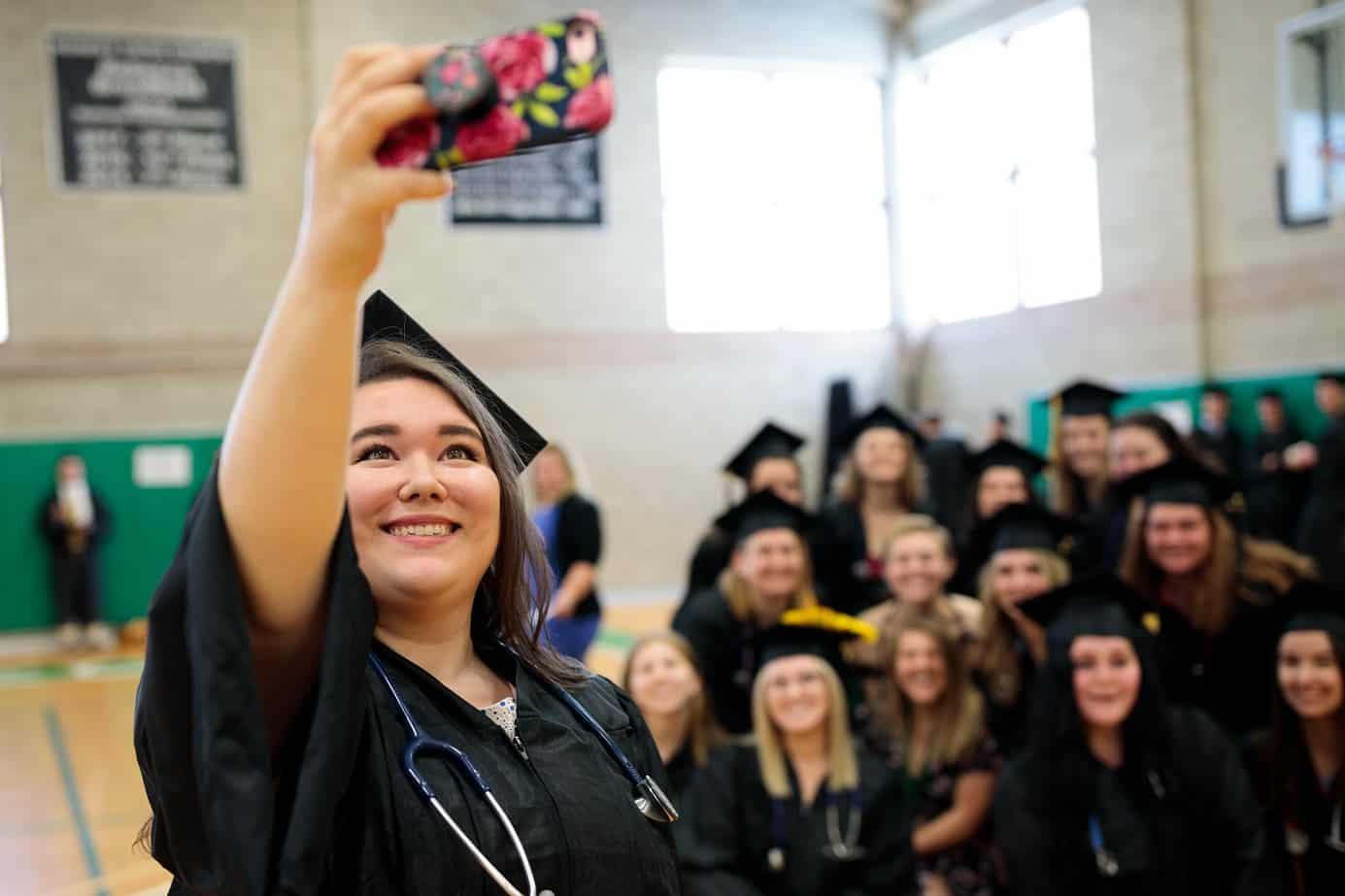 Nursing students, female, posing for group selfie, commencement, graduation