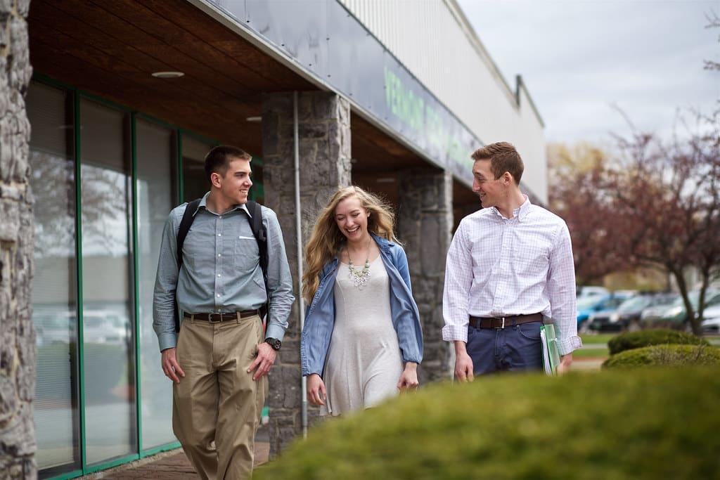 Williston campus, female student, male students, talking, walking, smiling, conversation