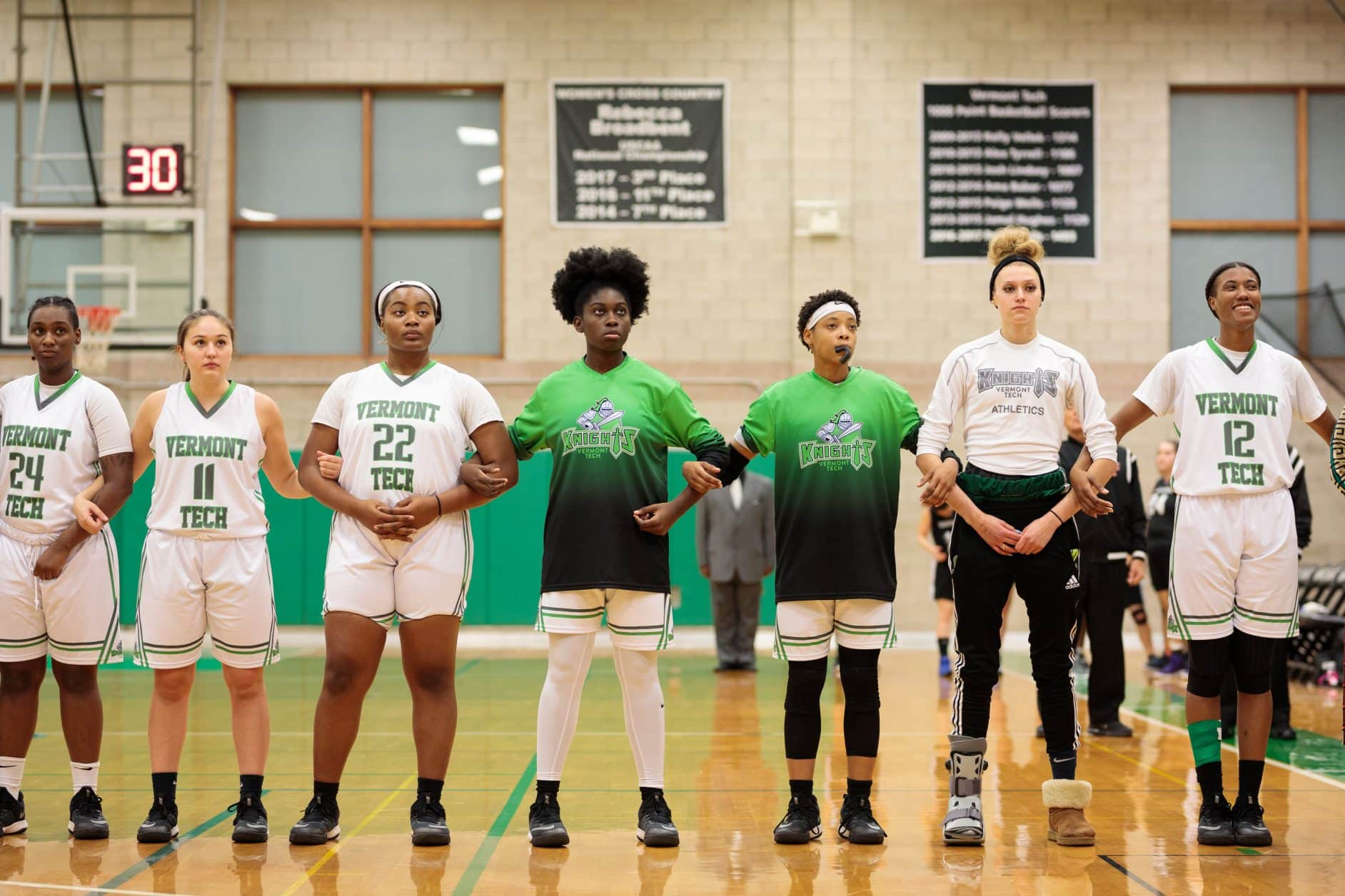 Women's baskeball team, standing together, game, uniforms