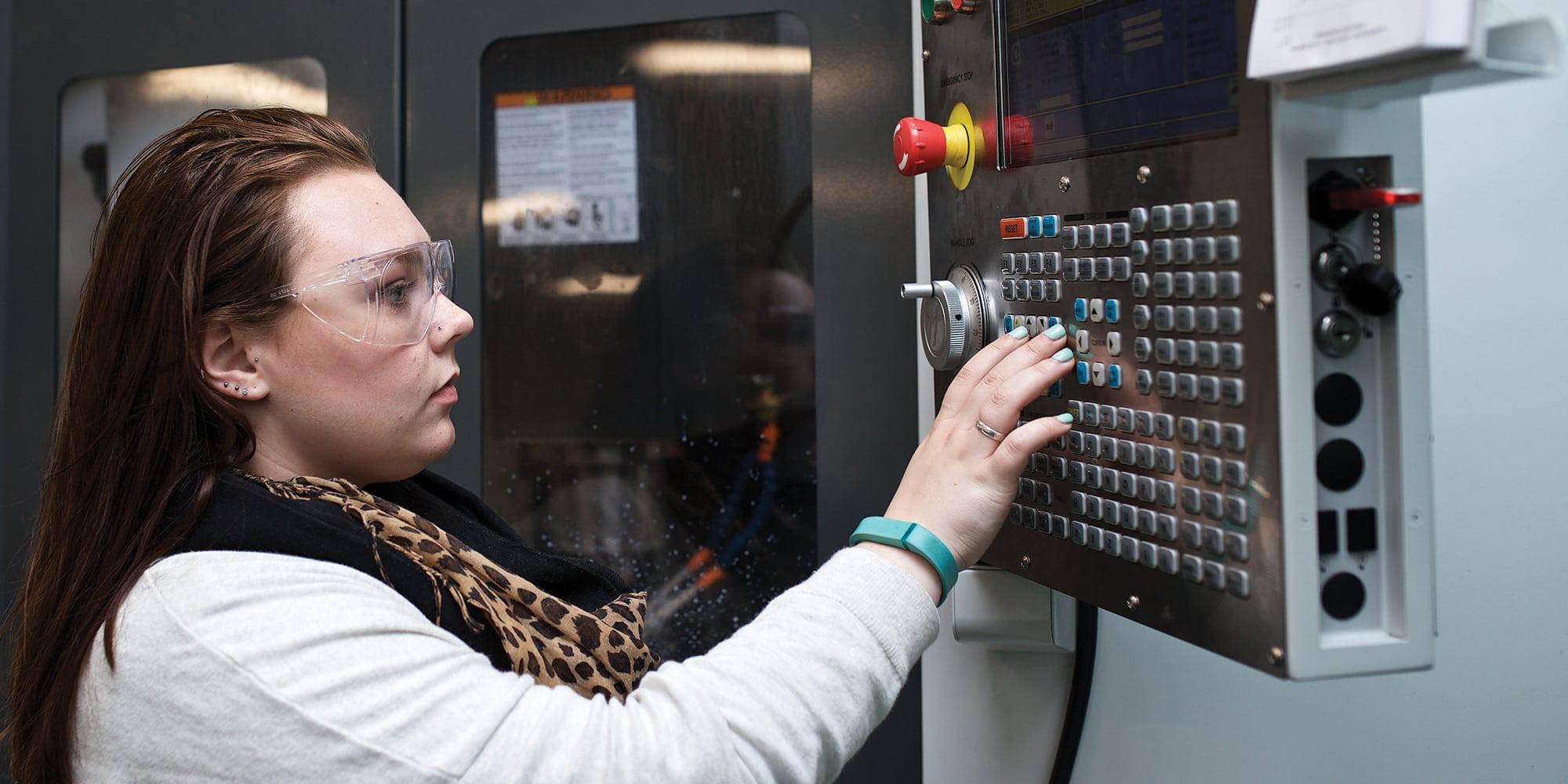 Female student, Emma, mechanical engineering technology, HAAS machinery, lab