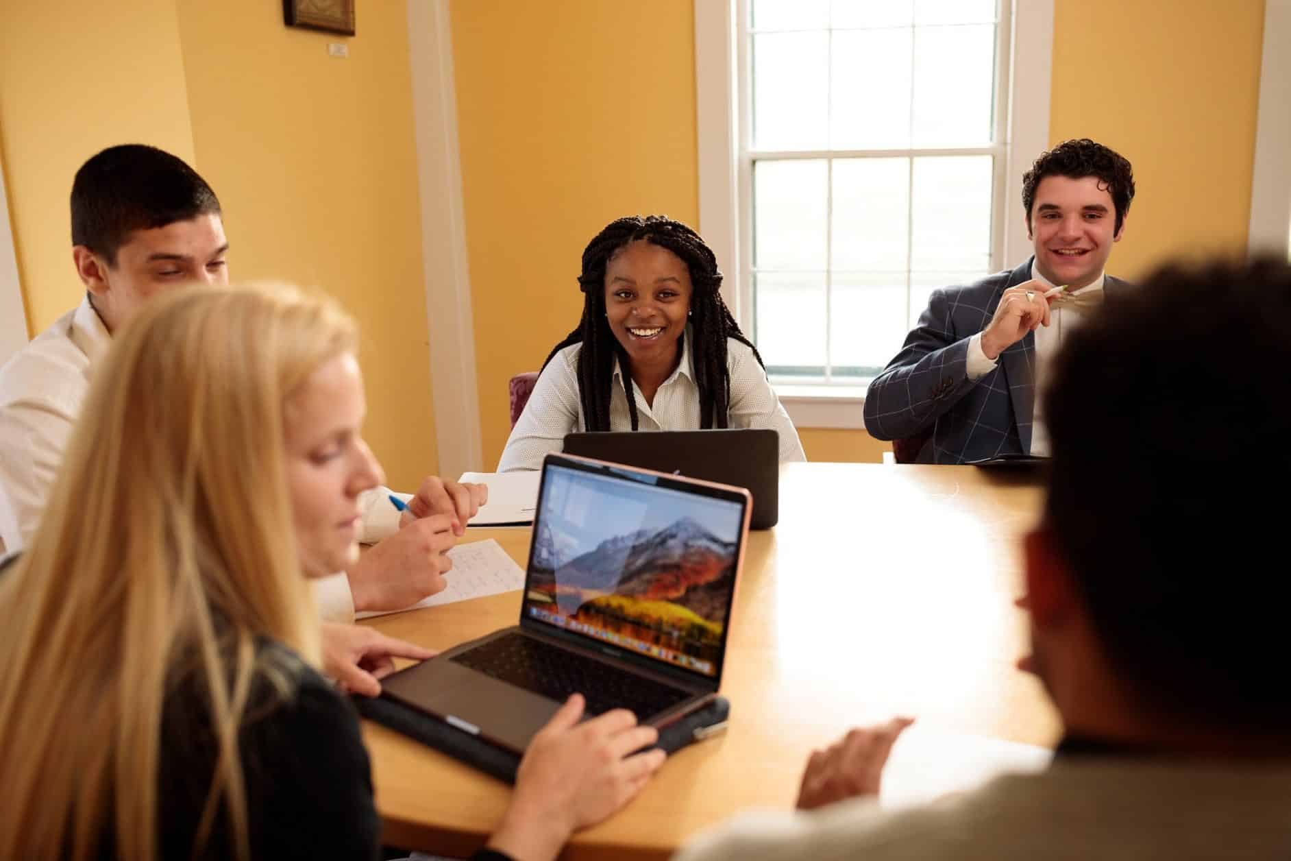 Female students, male students, conference room, business technology and management, laptops, notes
