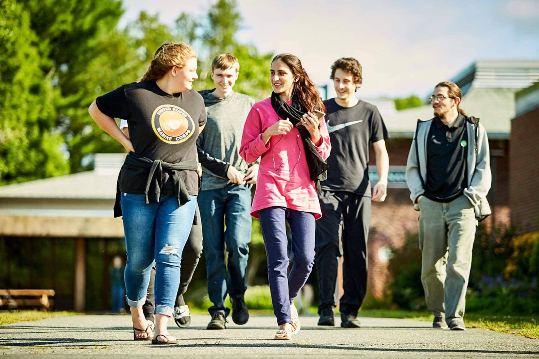 female students, male students, walking, sun, smiling, happy