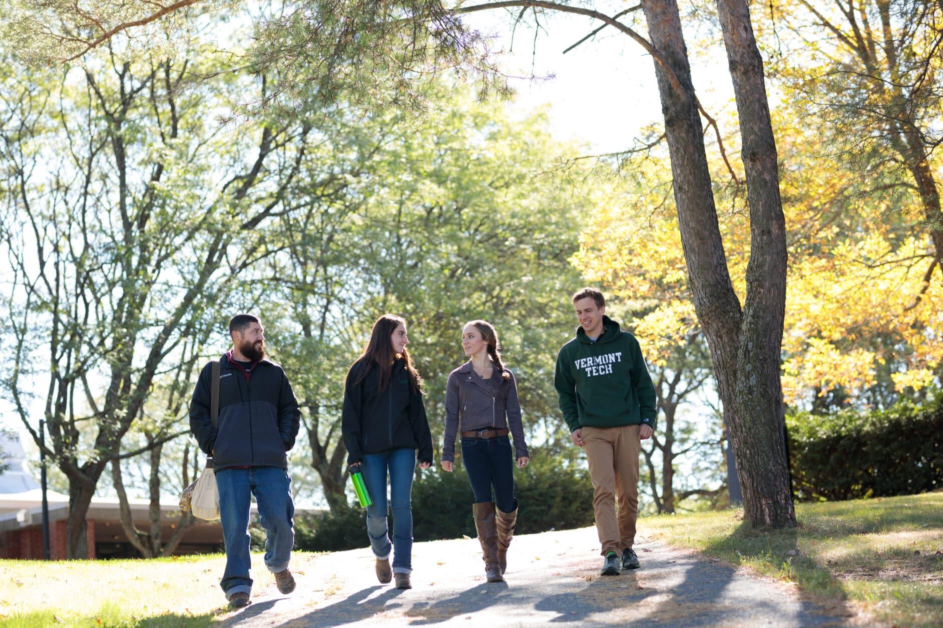 Students walking on Randolph Center campus; sunshine; happy