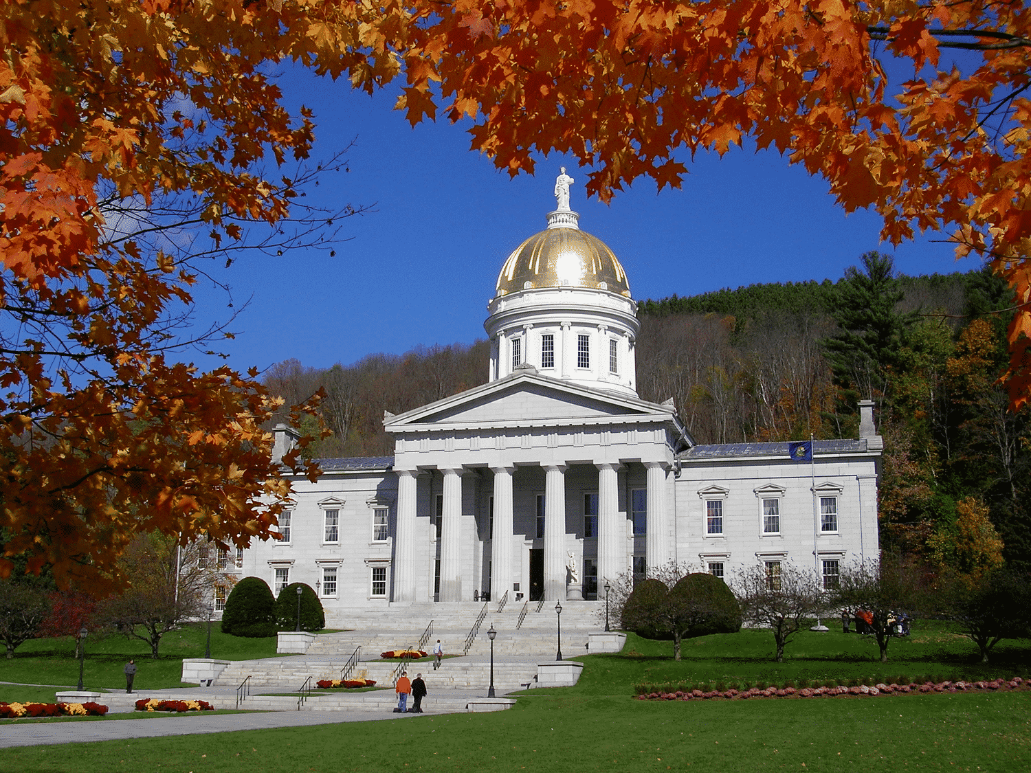 Exterior photo of the Vermont Statehouse in fall