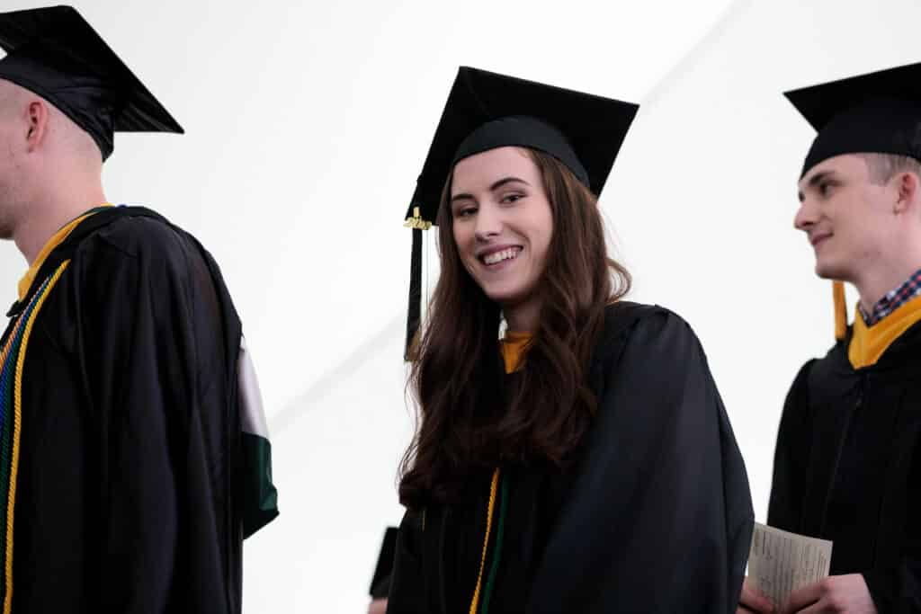 Graduation, commencement, smiling grad, female