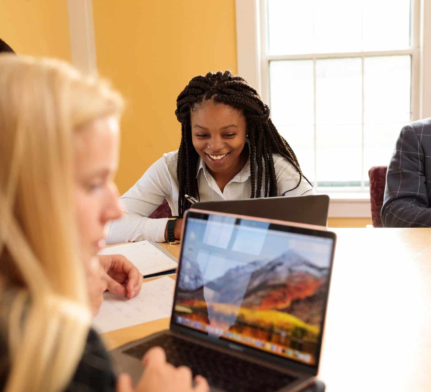 Female students, business technology and management, conference room, lap top, diversity